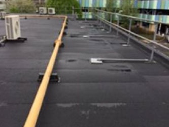 NHS Flat roofing contractor